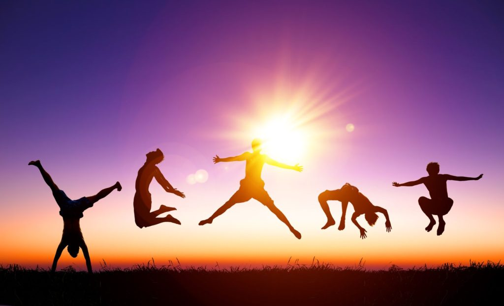 34001848 - happy young people jumping on the hill with sunlight background